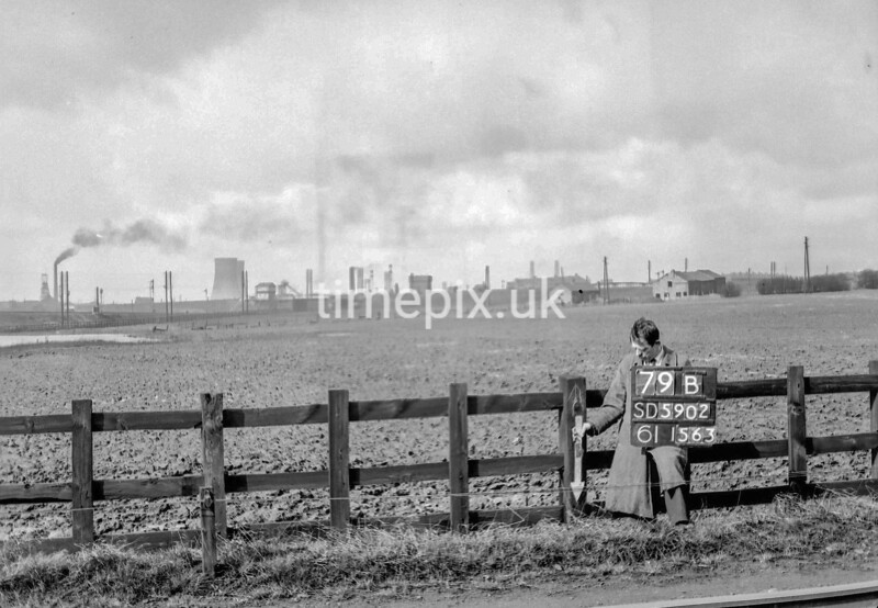 SD590279B, Man marking Ordnance Survey minor control revision point with an arrow in 1950s