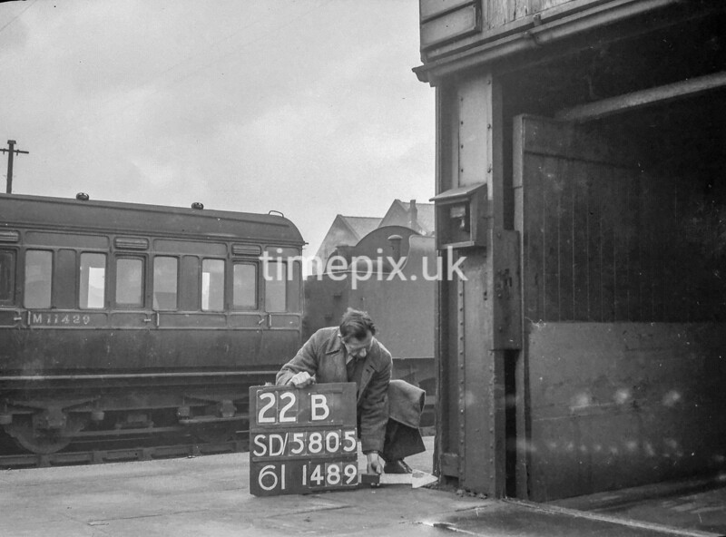 SD580522B, Man marking Ordnance Survey minor control revision point with an arrow in 1950s