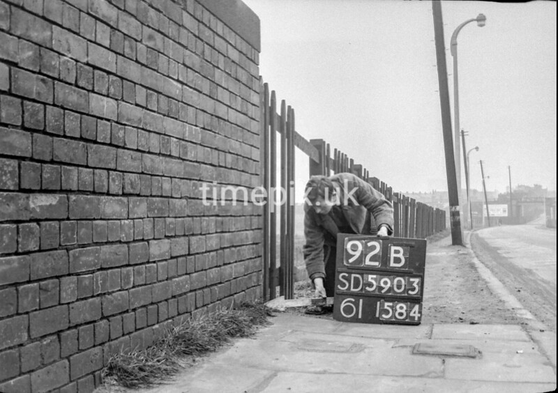 SD590392B, Man marking Ordnance Survey minor control revision point with an arrow in 1950s