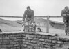 SD590587A, Man marking Ordnance Survey minor control revision point with an arrow in 1950s