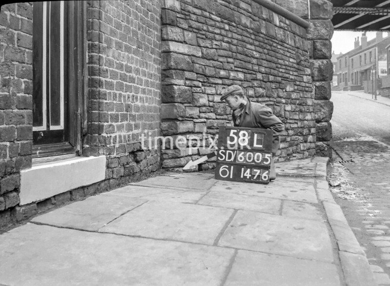 SD600558L, Man marking Ordnance Survey minor control revision point with an arrow in 1950s