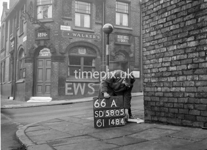 SD580566A, Man marking Ordnance Survey minor control revision point with an arrow in 1950s