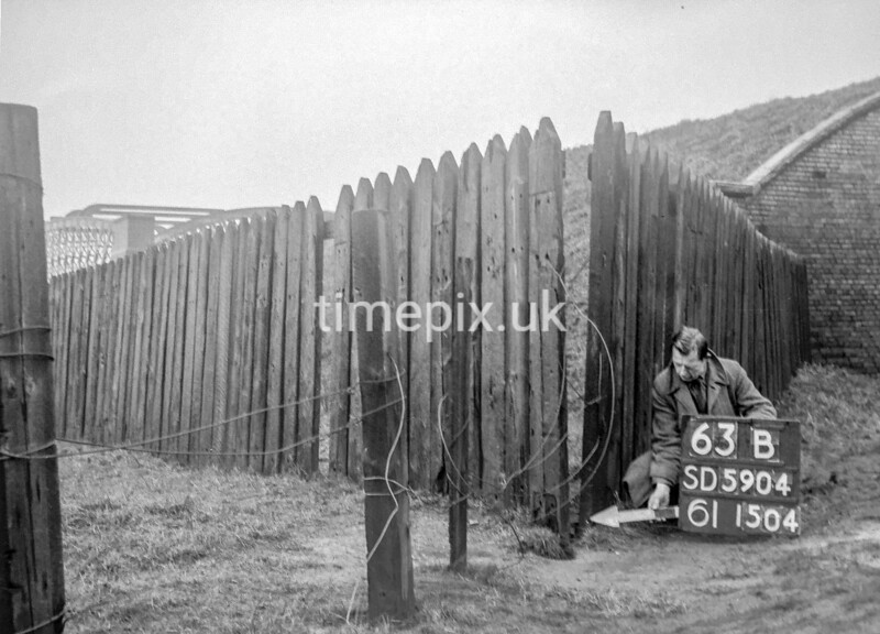 SD590463B, Man marking Ordnance Survey minor control revision point with an arrow in 1950s