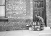 SD590581B, Man marking Ordnance Survey minor control revision point with an arrow in 1950s
