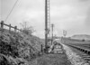 SD610512B, Man marking Ordnance Survey minor control revision point with an arrow in 1950s