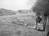 SD590586A, Man marking Ordnance Survey minor control revision point with an arrow in 1950s