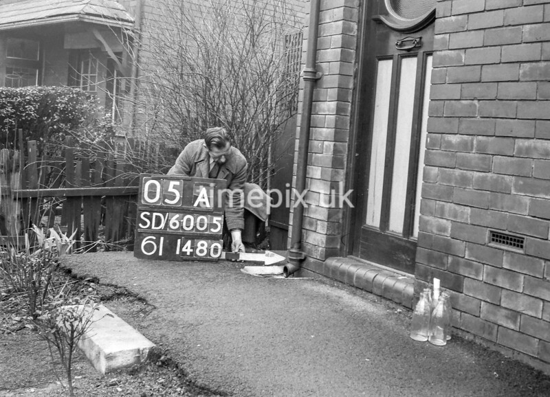 SD600505A, Man marking Ordnance Survey minor control revision point with an arrow in 1950s