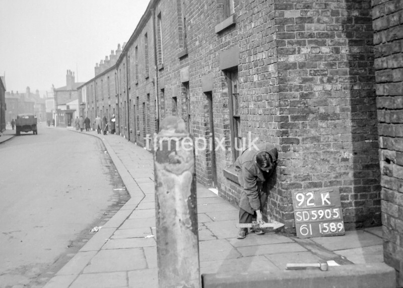 SD590592K, Man marking Ordnance Survey minor control revision point with an arrow in 1950s