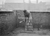 SD590508B, Man marking Ordnance Survey minor control revision point with an arrow in 1950s