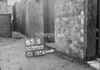 SD590365S, Man marking Ordnance Survey minor control revision point with an arrow in 1950s