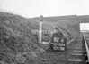 SD590482A, Man marking Ordnance Survey minor control revision point with an arrow in 1950s