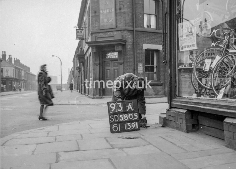 SD580593A, Man marking Ordnance Survey minor control revision point with an arrow in 1950s