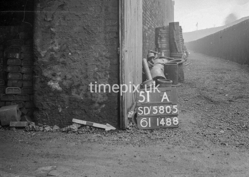 SD580551A, Man marking Ordnance Survey minor control revision point with an arrow in 1950s
