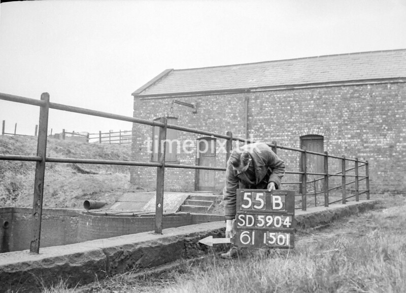 SD590455B, Man marking Ordnance Survey minor control revision point with an arrow in 1950s