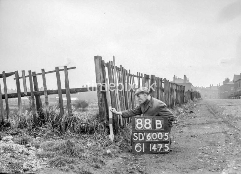 SD600588B, Man marking Ordnance Survey minor control revision point with an arrow in 1950s