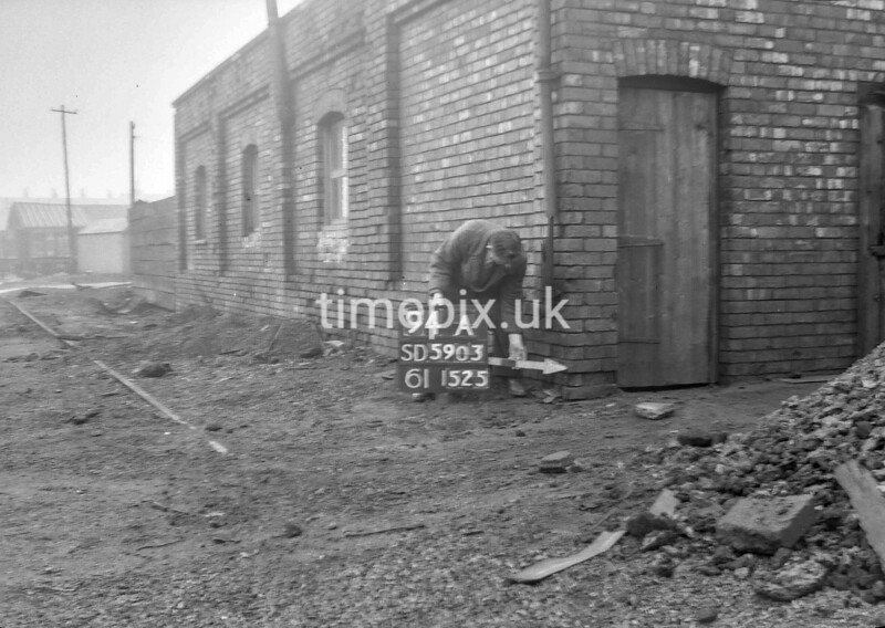 SD590394A, Man marking Ordnance Survey minor control revision point with an arrow in 1950s