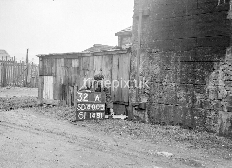 SD600532A, Man marking Ordnance Survey minor control revision point with an arrow in 1950s