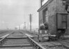 SD590311B, Man marking Ordnance Survey minor control revision point with an arrow in 1950s