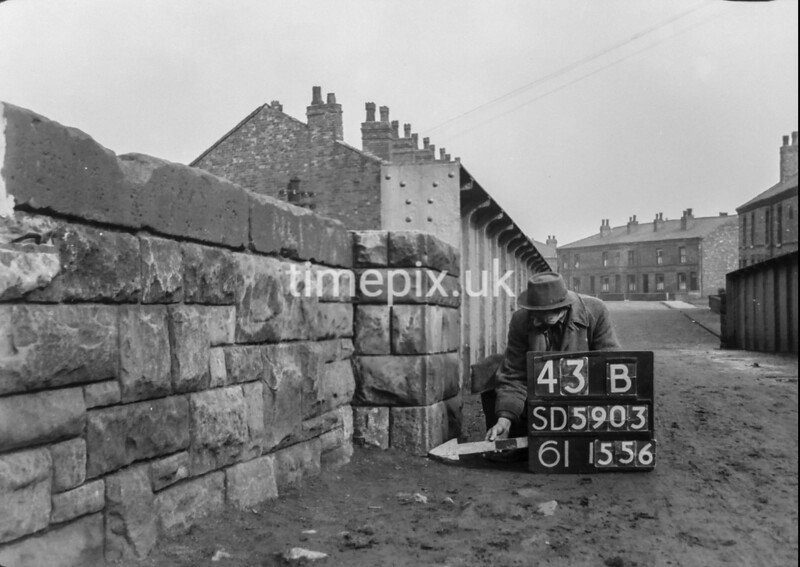 SD590343B, Man marking Ordnance Survey minor control revision point with an arrow in 1950s