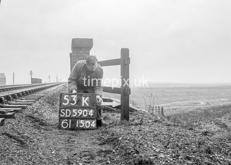 SD590453K, Man marking Ordnance Survey minor control revision point with an arrow in 1950s