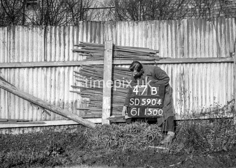 SD590447B, Man marking Ordnance Survey minor control revision point with an arrow in 1950s