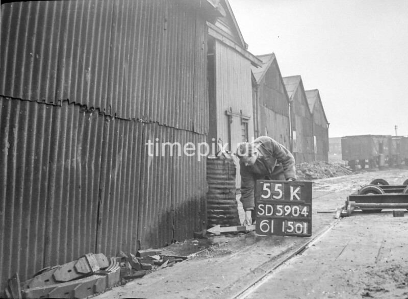 SD590455K, Man marking Ordnance Survey minor control revision point with an arrow in 1950s
