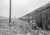 SD600522A2, Man marking Ordnance Survey minor control revision point with an arrow in 1950s