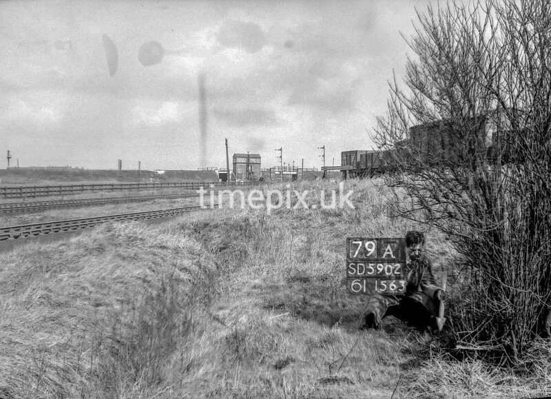 SD590279A, Man marking Ordnance Survey minor control revision point with an arrow in 1950s