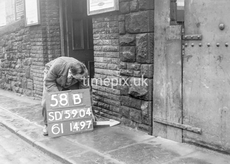 SD590458B, Man marking Ordnance Survey minor control revision point with an arrow in 1950s