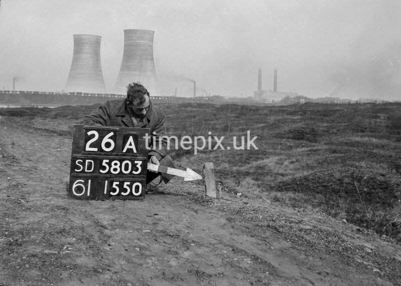 SD580326A, Man marking Ordnance Survey minor control revision point with an arrow in 1950s