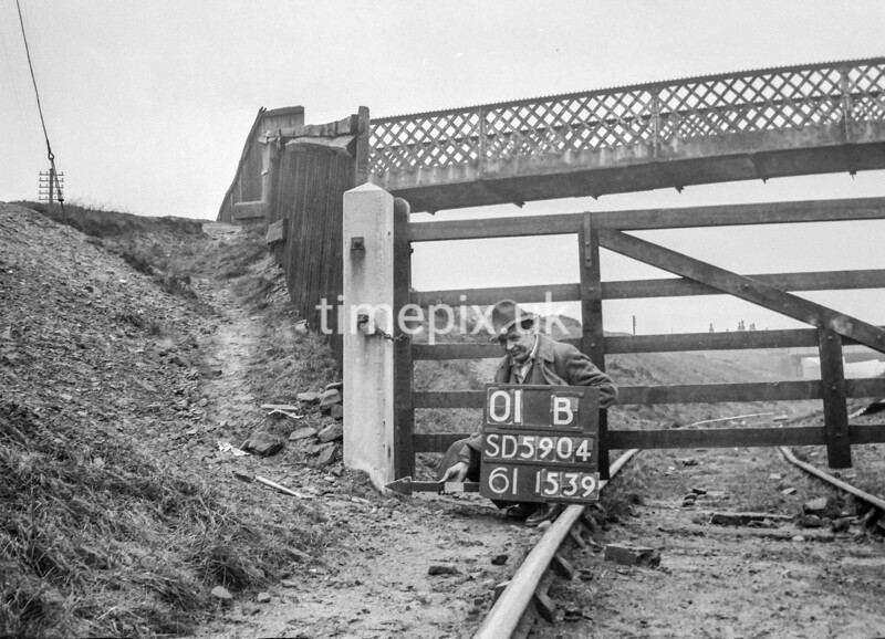 SD590401B, Man marking Ordnance Survey minor control revision point with an arrow in 1950s