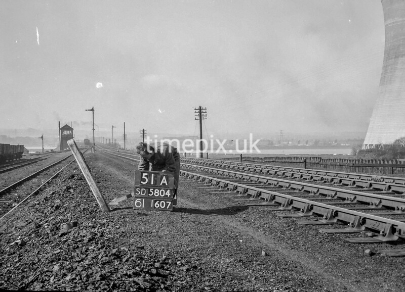 SD580451A, Man marking Ordnance Survey minor control revision point with an arrow in 1950s