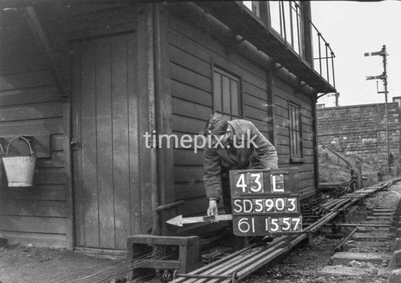 SD590343L, Man marking Ordnance Survey minor control revision point with an arrow in 1950s