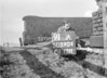 SD590491A, Man marking Ordnance Survey minor control revision point with an arrow in 1950s