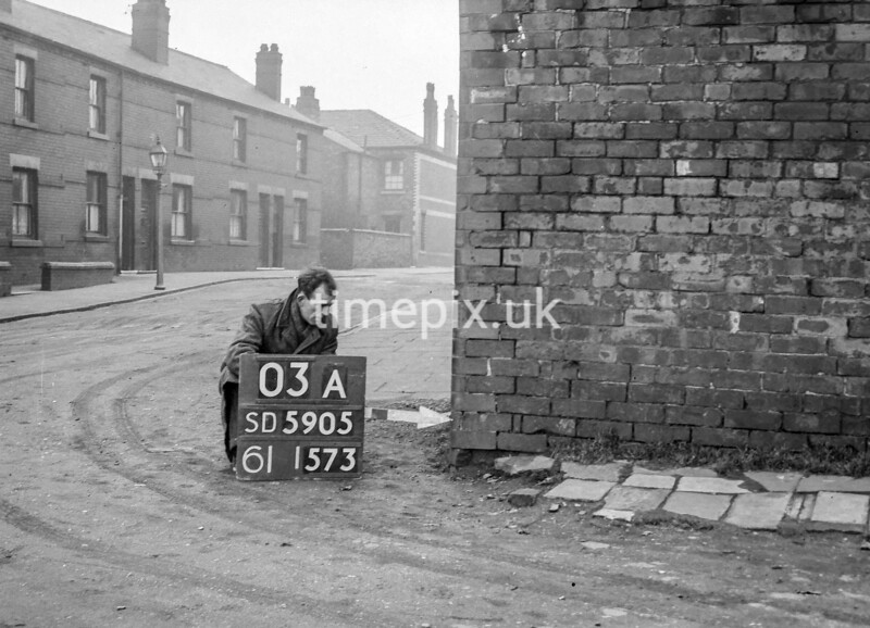 SD590503A, Man marking Ordnance Survey minor control revision point with an arrow in 1950s