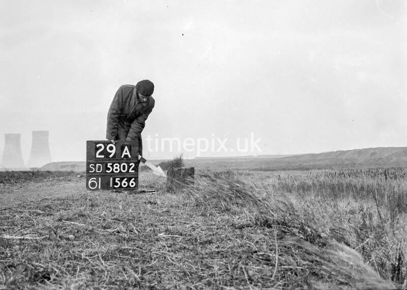 SD580229A, Man marking Ordnance Survey minor control revision point with an arrow in 1950s