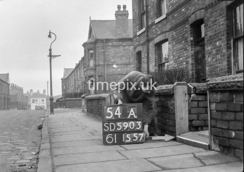 SD590354A, Man marking Ordnance Survey minor control revision point with an arrow in 1950s