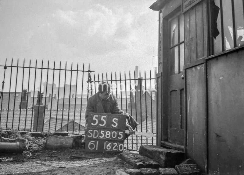 SD580555S, Man marking Ordnance Survey minor control revision point with an arrow in 1950s