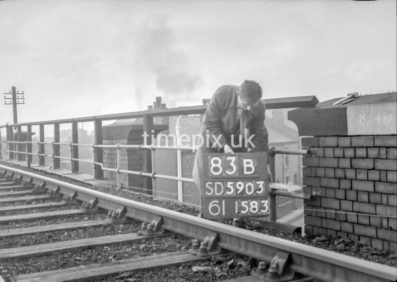 SD590383B, Man marking Ordnance Survey minor control revision point with an arrow in 1950s