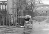 SD590357L, Man marking Ordnance Survey minor control revision point with an arrow in 1950s