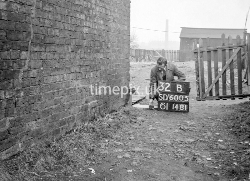 SD600532B, Man marking Ordnance Survey minor control revision point with an arrow in 1950s