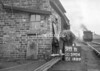 SD590498B, Man marking Ordnance Survey minor control revision point with an arrow in 1950s