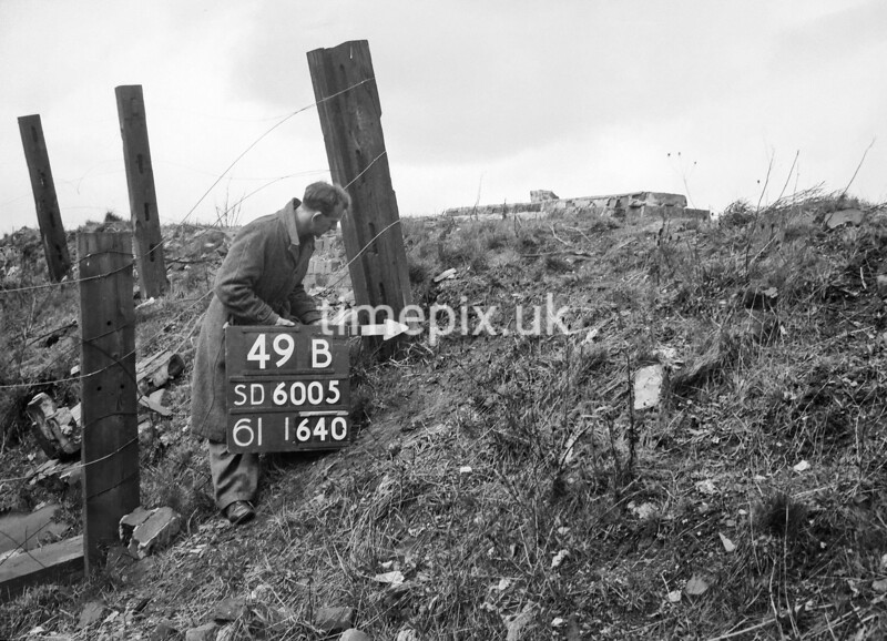 SD600549B, Man marking Ordnance Survey minor control revision point with an arrow in 1950s
