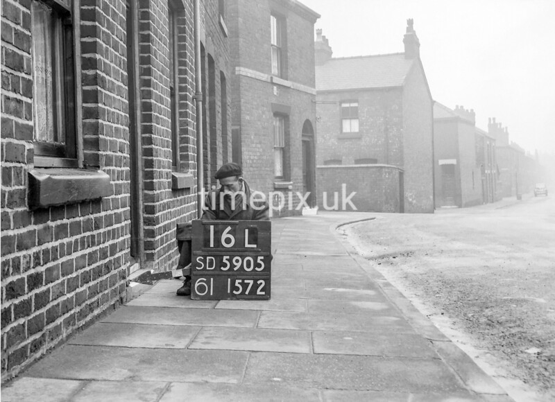 SD590516L, Man marking Ordnance Survey minor control revision point with an arrow in 1950s