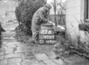SD600573A, Man marking Ordnance Survey minor control revision point with an arrow in 1950s