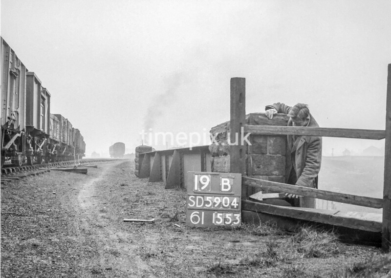SD590419B, Man marking Ordnance Survey minor control revision point with an arrow in 1950s
