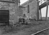 SD590303B, Man marking Ordnance Survey minor control revision point with an arrow in 1950s