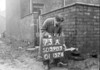 SD590373A, Man marking Ordnance Survey minor control revision point with an arrow in 1950s