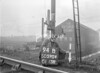 SD590494B, Man marking Ordnance Survey minor control revision point with an arrow in 1950s