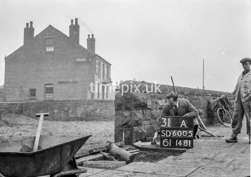 SD600531A, Man marking Ordnance Survey minor control revision point with an arrow in 1950s